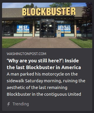"By The Washington Post. Photo o' storefront o' Blockbuster. ""A man parked his motorcycle on the sidewalk Saturday morning, ruining the aesthetic of the last remaining Blockbuster in the contiguous United"""