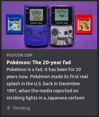 By Polygon. Photo o' 2 Game Boy Colors side-by-side in the center, 1 playing Pokémon Yellow, the other playing Pokémon Gold. On either side o' them are cartridges for Pokémon Blue & Red.