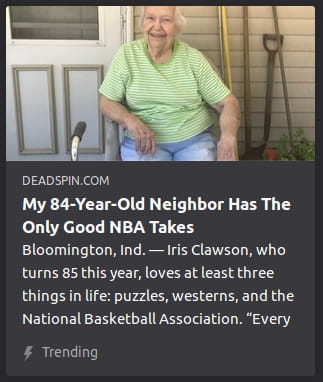 By Deadspin. Photo o' an ol' woman sitting in front o' a suburban home.