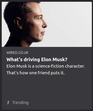 By Wired. Photo o' Elon Musk in profile, putting on his best lifeless robot impression in front o' a white void.